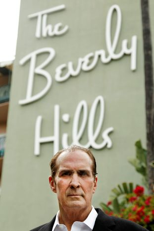 """Robert S. Anderson, author and Beverly Hills Hotel historian, poses for a portrait in front of the Beverly Hills Hotel in Beverly Hills, Calif. Anderson's book """"The Beverly Hills Hotel - The First 100 Years"""" celebrates the 100th anniversary of the Beverly Hills Hotel. (AP Photo/Matt Sayles)"""
