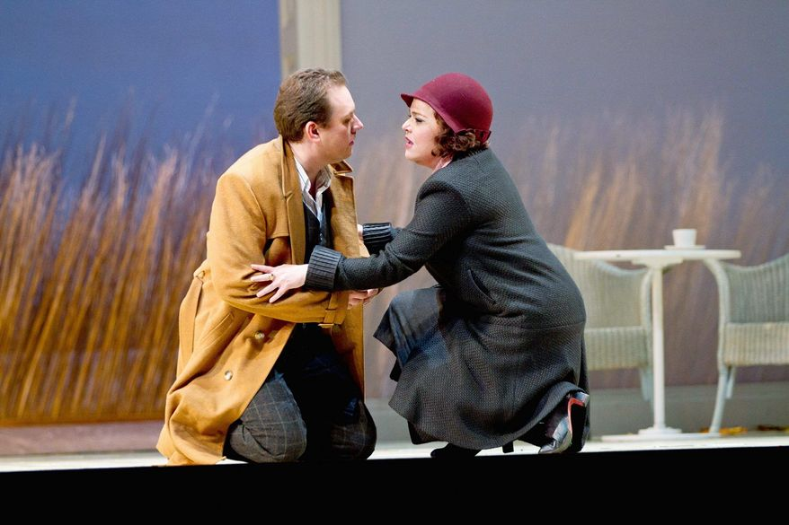 """Francesco Meli as Werther becomes infatuated with Sonia Ganassi as Charlotte, who is engaged to another man, in """"Werther."""" The Washington National Opera production closes May 27. (Scott Suchman/Washington National Opera)"""