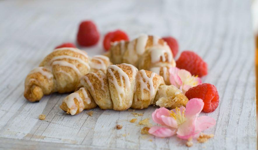 The trick to making delicious croissants comparatively quickly is to outsource the pastry. And try adding some berries before serving warm. (Associated Press)