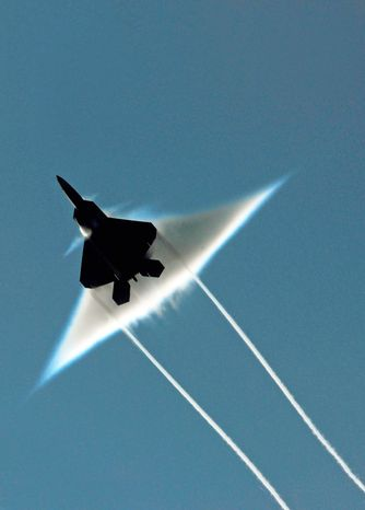 One pilot died from oxygen deprivation while flying the Air Force's F-22 Raptor, seen here in a supersonic flyby, and 25 have returned from missions under the same condition. (Associated Press)