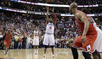 Philadelphia 76ers' Andre Iguodala shoots the go-ahead free throw in Game 6 of first-round playoff series against the Chicago Bulls on Thursday, May 10, 2012, in Philadelphia. Philadelphia won 79-78 and won the series 4-2. (AP Photo/Matt Slocum)