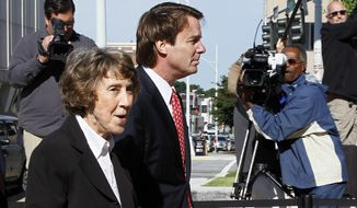 Former Sen. John Edwards arrives with his mother, Bobbie Edwards, at the federal courthouse in Greensboro, N.C., on Thursday, May 10, 2012, for his trial on charges of violating campaign-finance laws. (AP Photo/Gerry Broome)