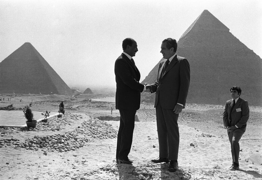 In this June 14, 1974 file photo taken by Associated Press photographer Horst Faas, Presidents Anwar Sadat and Richard Nixon shake hands for photographers as they pose in front of the pyramids at Giza, near Cairo. Faas, a prize-winning combat photographer who carved out new standards for covering war with a camera and became one of the world's legendary photojournalists in nearly half a century with The Associated Press, died Thursday May 10, 2012. He was 79. (AP Photo/Horst Faas, File)
