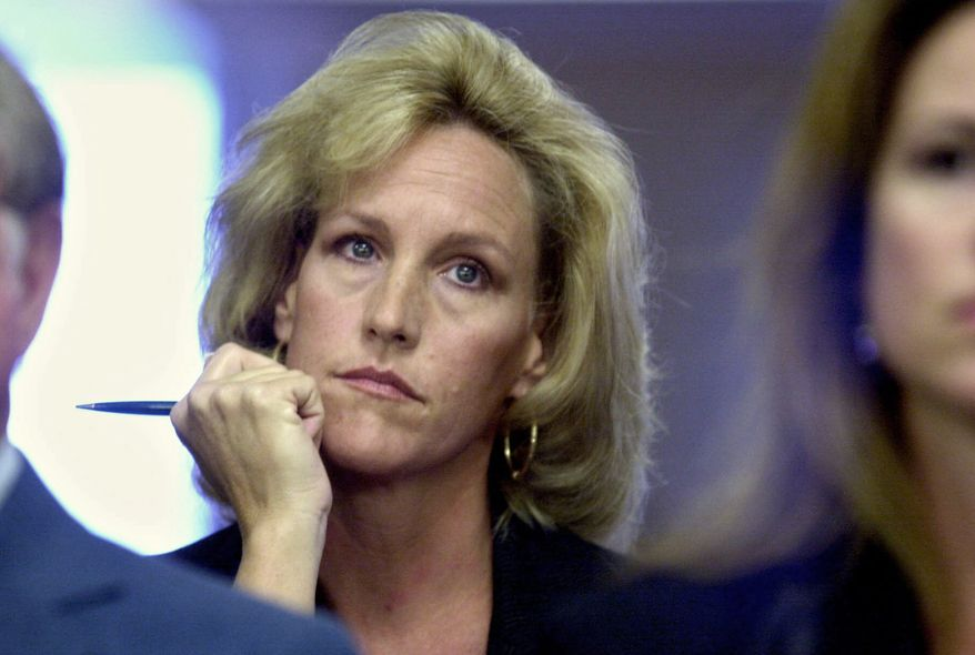 **FILE** Erin Brockovich listens Sept. 15, 2000, to a presentation to the Los Angeles City Council by the Los Angeles Department of Water and Power. (Associated Press)