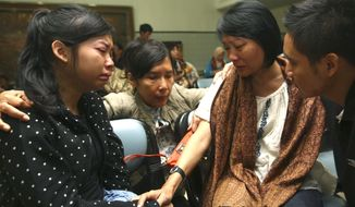 Relatives weep as they wait for news on the missing Russian airplane at Halim Perdanakusuma Airport in Jakarta, Indonesia, Thursday, May 10, 2012. (AP Photo/Tatan Syuflana)
