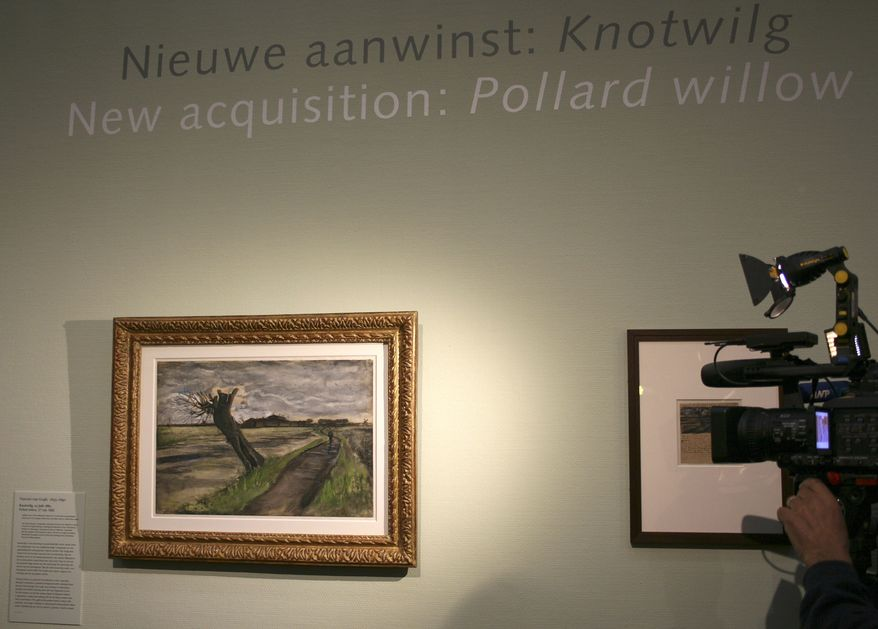 A cameraman films an 1882 water color of a pollard willow by Vincent van Gogh at the Van Gogh Museum in Amsterdam on May 10, 2012. The Van Gogh Museum unveiled the painting earlier that day, the first addition in five years to its world-famous collection of works by the post-impressionist. (Associated Press)