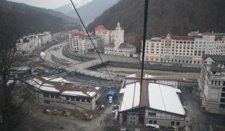 Hotels are under construction in December 2011 at the Rosa Khutor ski resort in Krasnaya Polyana, Russia, near the Black Sea resort of Sochi, site of the 2014 Winter Olympics. (AP Photo/Igor Yakuninm)