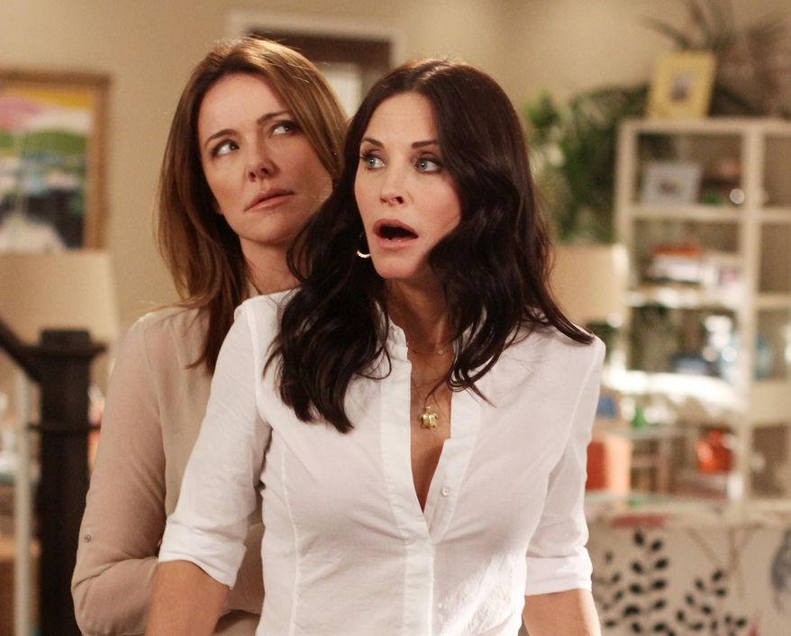 """In this publicity image released by ABC, Christa Miller, left and Courteney Cox are shown in a scene from the ABC comedy """"Cougar Town."""" The ABC sitcom, a cult favorite but never a ratings blockbuster on broadcast television, will be moving to cable's TBS, the network said Thursday, May 10, 2012. (AP Photo/ABC, Michal Ansell)"""
