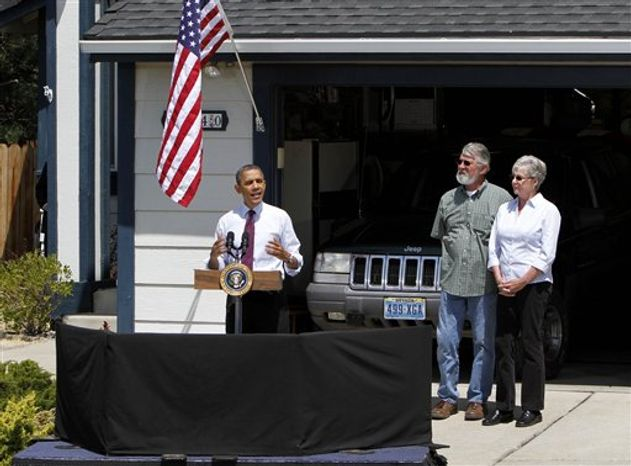 President Barack Obama, accompanied by Val and Paul Keller, talks about home mortgages, Friday, May 11, 2012, outside the Kellers home in Reno, Nev. Obama met with the Kellers who recently refinanced their home loan under a federally backed program that the President wants to expand to all homeowners who are paying their mortgages on time.(AP Photo/Rich Pedroncelli)