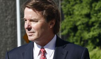 Former presidential candidate and North Carolina Sen. John Edwards arrives May 10, 2012, at a federal courthouse in Greensboro, N.C. Edwards is accused of conspiring to secretly obtain more than $900,000 from two wealthy supporters to hide his extramarital affair with Rielle Hunter and her pregnancy. (Associated Press)