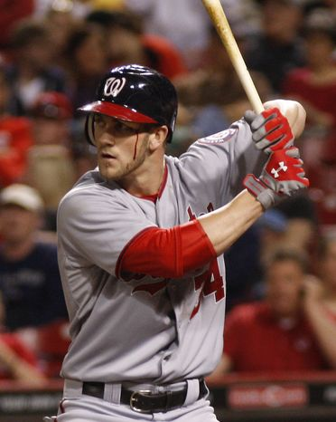 Washington Nationals' Bryce Harper waits for a pitch from Cincinnati Reds pitcher Sam LeCure during the ninth inning Friday, May 11, 2012, in Cincinnati. The Nationals won 7-3. (AP Photo/David Kohl)