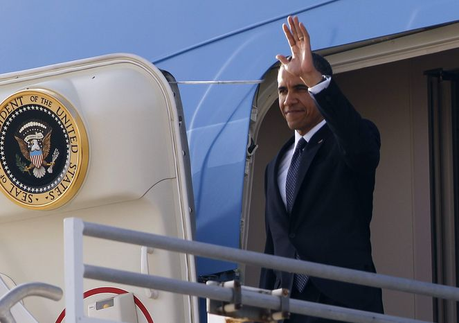 President Barack Obama waves as he arrives at Los Angeles International Airport, Thursday, May 10, 2012, in Los Angeles. (AP Photo/Pablo Martinez Monsivais)