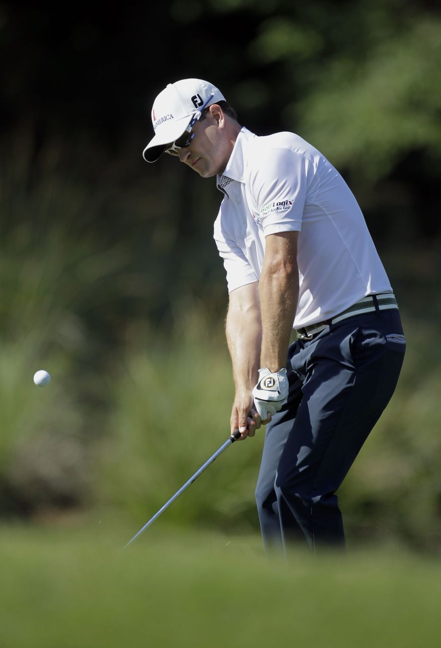 Zach Johnson chips onto the seventh green during the second round of the Players Championship at TPC Sawgrass on Friday, May 11, 2012, in Ponte Vedra Beach, Fla. (AP Photo/John Raoux)