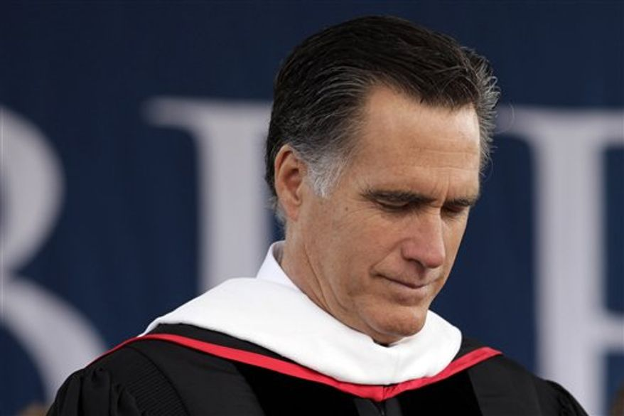 Republican presidential candidate, former Massachusetts Gov. Mitt Romney, prays before his commencement address at the Liberty University in Lynchburg, Va, Saturday, May 12, 2012. (AP Photo/Jae C. Hong)