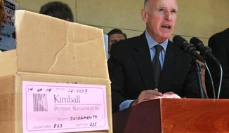 Gov. Jerry Brown discusses his tax-hike initiative before submitting the petitions for the initiative to the Sacramento County Registrar of Voters in Sacramento, Calif., Thursday, May 10, 2012. (AP Photo/Rich Pedroncelli)