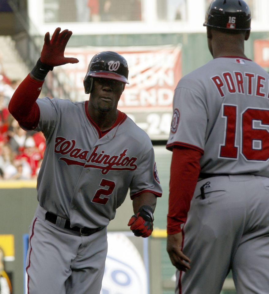 Washington Nationals' Roger Bernadina heads toward home plate past after hitting a two-run home run off Cincinnati Reds starting pitcher Mike Leake during the first inning on Friday, May 11, 2012, in Cincinnati. (AP Photo/David Kohl)
