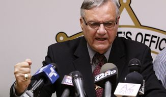 A defiant Maricopa County Sheriff Joe Arpaio pounds his fist on the podium as he answers questions regarding the Department of Justice announcing a federal civil lawsuit against him and his department, during a news conference Thursday, May 10, 2012, in Phoenix. (AP Photo/Ross D. Franklin)