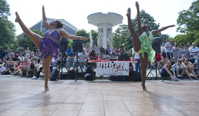 Jessica Pritchett, 18, left, of Suitland, Md., and Tabria Green, 16, of Washington, D.C., both senior dance company members with Dance Dimensions in Forestville, Md., perform on stage at Dupont Circle as part of Dance in the Circle.  (Barbara L. Salisbury/The Washington Times)