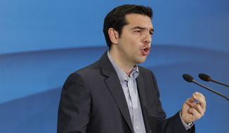 Alexis Tsipras, leader of Greece's Coalition of the Radical Left party, or Syriza, speaks to reporters after meeting with Socialist leader Evangelos Venizelos at the Greek parliament in Athens on Friday, May 11 2012. (AP Photo/Kostas Tsironis)