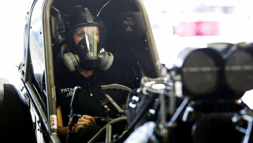 Alexis DeJoria straps herself into her funny car in Jupiter, Fla. She is  a ranked National Hot Rod Association driver and the second woman to win a National event in funny car. (AP Photo/J Pat Carter)