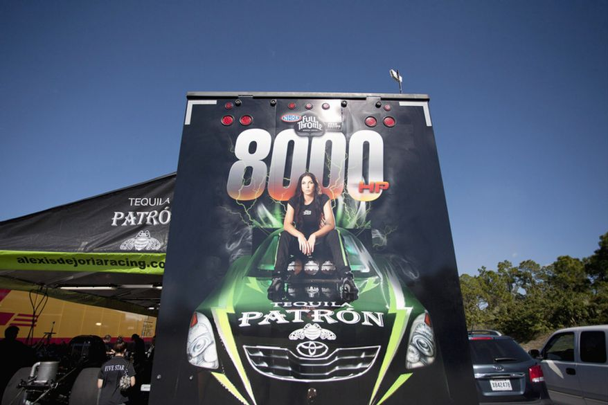 Alexis DeJoria's photo decorates the back of her haul trailer at a racetrack in Jupiter, Fla.  (AP Photo/J Pat Carter)