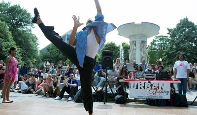 Phillip Fobbs, 16, of Bowie, Md., a senior dance company member with Dance Dimensions in Forestville, Md., performs on stage at Dupont Circle on Sunday as part of Dance in the Circle, a dance festival. The event was organized by Circle Productions, who also organized a snowball fight in the circle and Soccer in the Circle, both in 2010. (Barbara L. Salisbury/The Washington Times)
