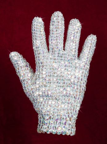 A right-hand glove covered in crystals is among Michael Jackson's costumes and personal fashion items to be auctioned Dec. 2 after an international tour. They are by his longtime designers Dennis Tompkins and Michael Bush. (Julien's Auctions via Associated Press)