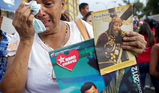 A supporter of Mr. Chavez tears up during his caravan's procession to the airport in Caracas, Venezuela, for his flight to Cuba for cancer surgery on Feb. 24. (Associated Press)