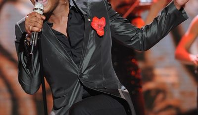 """Contestant Joshua Ledet performs Wednesday on """"American Idol."""" He earned the right to remain in the competition, but the show has lost 25 percent of its audience this season, and Fox is promising undisclosed changes for next season. (Associated Press)"""