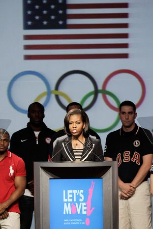 """Michelle Obama is behind the """"Let's Play!"""" program, a fitness initiative aimed at combating childhood obesity. (Associated Press)"""