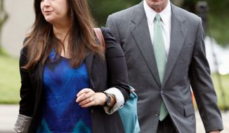 ** FILE ** Cate Edwards leads her father, John Edwards, into the federal courthouse in Greensboro, N.C., on Monday, May 14, 2012, as the defense starts in his corruption trial. (Associated Press)