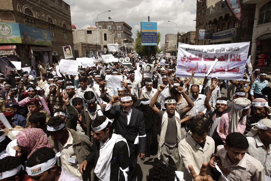 **FILE** Yemeni members of the Peaceful Revolution Salvation Front chant slogans during a demonstration demanding independence of the judicial system from government control in Sanaa, Yemen. (Associated Press)