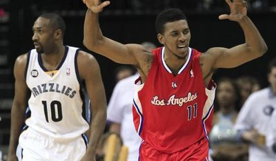Los Angeles Clippers guard Nick Young (11) celebrates after hitting a three-point basket as Memphis Grizzlies guard Gilbert Arenas follows him downcourt in the second half of Game 7 in a first-round NBA playoff series on Sunday, May 13, 2012, in Memphis, Tenn. The Clippers won 82-72 to take the series 4-3. (AP Photo/Mark Humphrey)