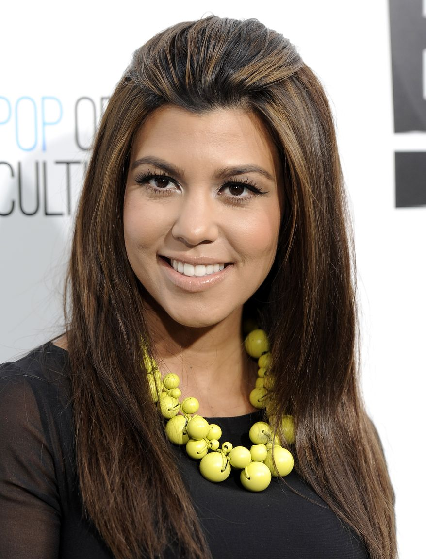 """Kourtney Kardashian of the reality show """"Keeping Up With The Kardashians"""" attends an E! Network upfront event April 30, 2012, at Gotham Hall in New York. (Associated Press)"""