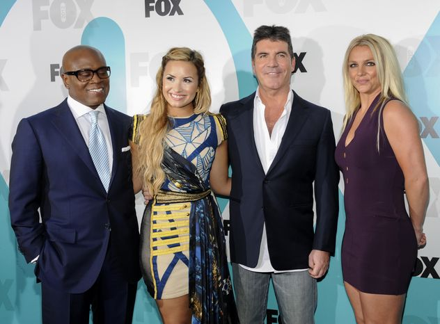 """""""The X Factor"""" judges, from left, L.A. Reid, Demi Lovato, Simon Cowell and Britney Spears attend the Fox network upfront presentation party at Wollman Rink, Monday, May 14, 2012 in New York. (AP Photo/Evan Agostini)"""