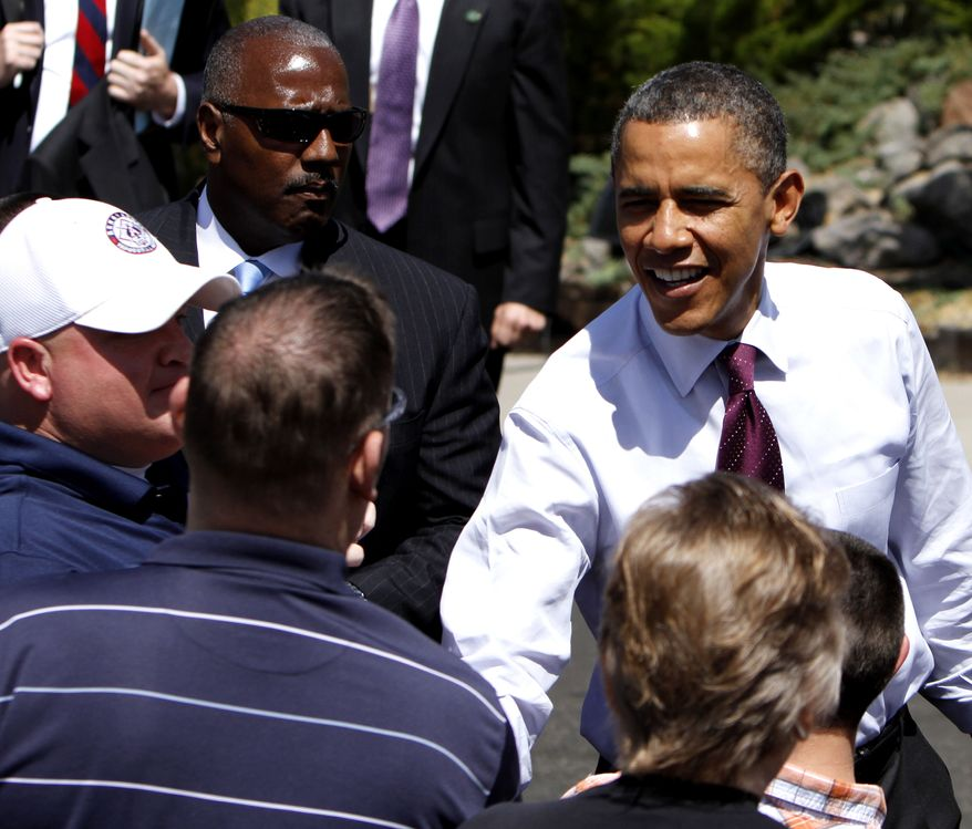 **FILE** President Obama visits with the crowd during his visit to the home of Val and Paul Keller, in Reno, Nev., on May 11, 2012. Obama met with the Kellers who recently refinanced their home loan under a federally backed program that the President wants to expand to all homeowners who are paying their mortgages on time. (Associated Press)