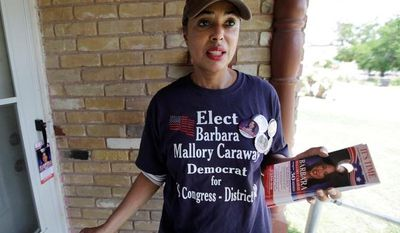 Texas state Rep. Barbara Mallory Caraway posts flyers for her campaign for the 30th Congressional District race on May 1. The Dallas Democrat is challenging Rep. Eddie Bernice Johnson, who has served in Congress since 1993. (Associated Press)