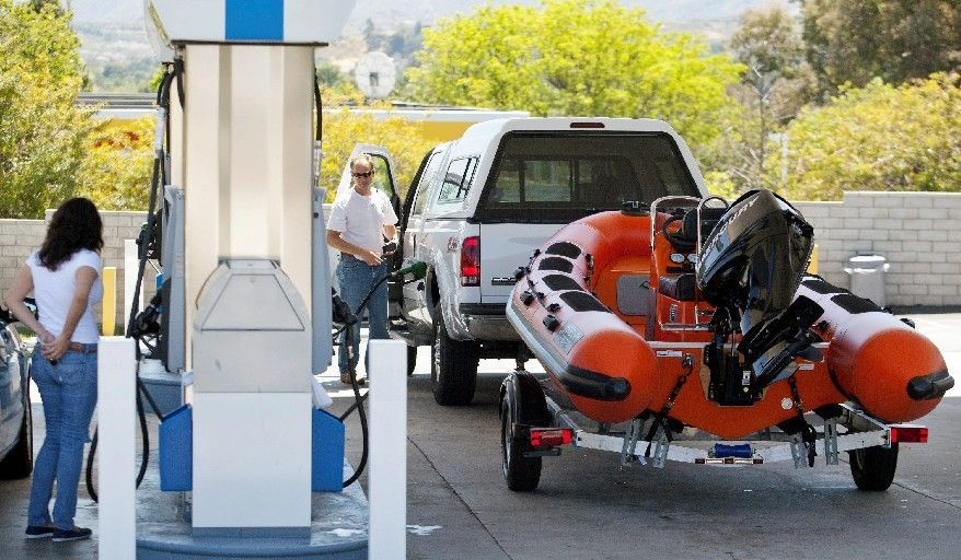 For Memorial Day weekend, auto club AAA estimates that 34.8 million Americans will take trips of at least 50 miles. Although gas prices have decreased recently, they are still high enough to keep some Americans off the road. (Associated Press)
