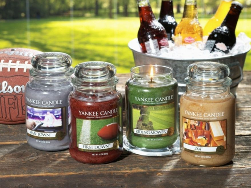 "Man Town, First Down, Riding Mower and 2x4 are the scents in the Yankee Candle Co.'s new Man Candles Collection. The ""down-to-earth fragrances"" are meant to suit one's basement, garage, car, man cave or bachelor pad. (Village Candle Co. Inc.)"
