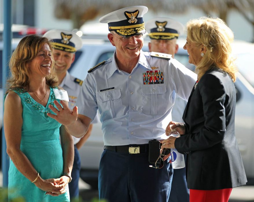 ** FILE ** Dr. Jill Biden meets with Sherry Kenin, left, and U.S. Coast Guard Rear Admiral William D. Baumgartner, who serves as the Commander, Seventh Coast Guard District, during a visit to Coast Guard Base Miami Beach on Thursday, May 3, 2012, in Miami Beach, Fla. (AP Photo/The Miami Herald, Al Diaz)