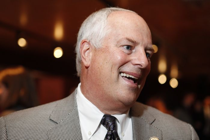 **FILE** Colonial Athletic Association Commissioner Tom Yeager is interviewed Oct. 20, 2009, during the CAA college basketball media day in Washington. (Associated Press)