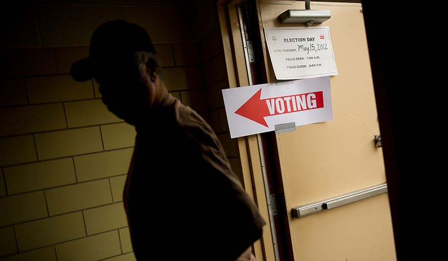 A D.C. resident who declined to give his name walks into a University of the District of Columbia Community College building, to cast a vote in a special election in this May 15, 2012 file photol. (Andrew Harnik/The Washington Times)  **FILE**