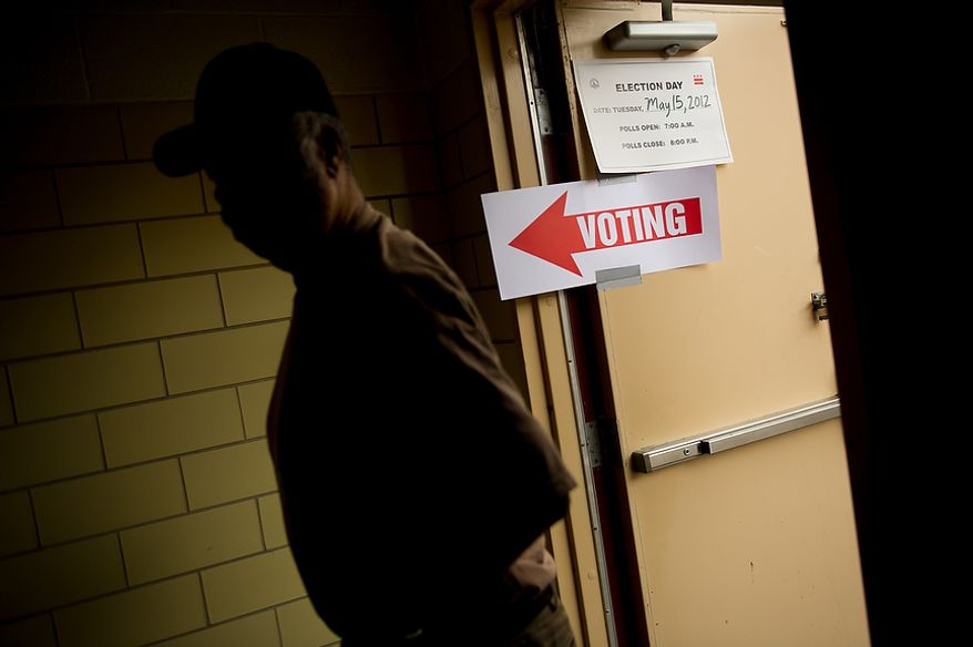 A D.C. resident who declined to give his name walks into a University of the District of Columbia Community College building, formerly Backus Middle School on South Dakota Avenue in northeast to vote in a special election to replace Harry Thomas for Ward 5 city councilmember, Washington, D.C., Tuesday, May 15, 2012 (Andrew Harnik/The Washington Times)