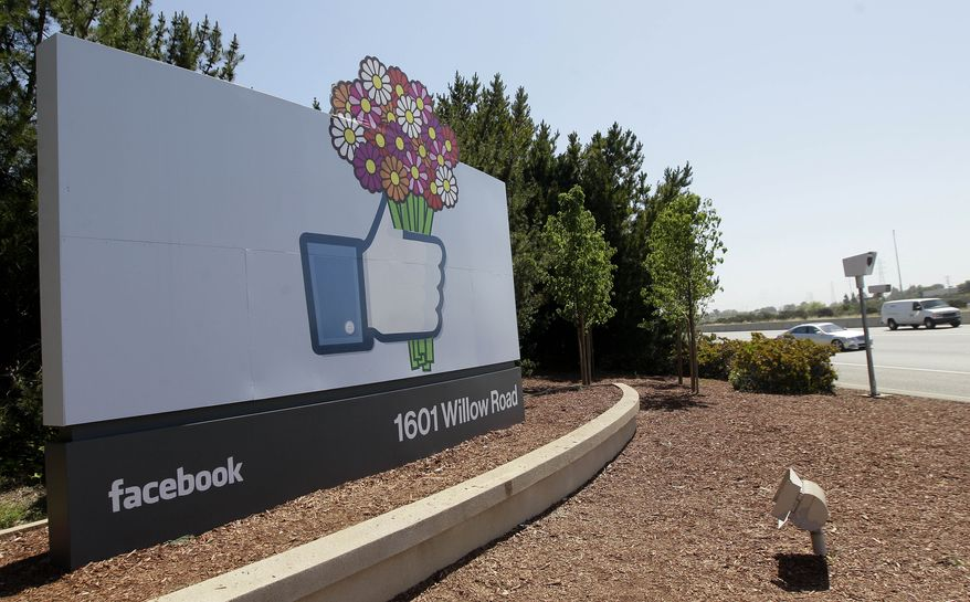 A sign is shown May 11, 2012, at the Facebook campus in Menlo Park, Calif. (Associated Press)