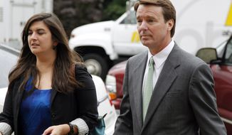 Former North Carolina Sen. John Edwards walks May 14, 2012, with his daughter, Cate Edwards, into a federal courthouse in Greensboro, N.C., as the defense continues in his campaign corruption trial. (Associated Press)