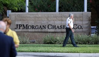 Hillsborough Sheriff deputy patrols outside the gate of JP Morgan Chase annual stockholders meeting held May 15, 2012, in Tampa, Fla. JPMorgan Chase CEO Jamie Dimon was scheduled speak to shareholders at the meeting, five days after disclosing a $2 billion trading loss. (Associated Press)