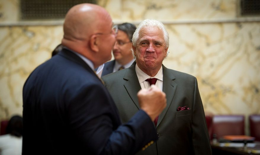 Maryland State Senate President Thomas V. Mike Miller, Jr., (right) shares a light moment with Maryland Senator E.J. Pipkin (R-District 36) during the second day of the General Assembly special session at the Maryland State House in Annapolis, Md., Tuesday, May 15, 2012. (Rod Lamkey Jr/The Washington Times)