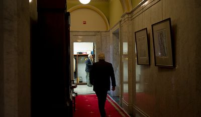 Maryland State Senate President Thomas V. Mike Miller, Jr., strolls down a back hallway before presiding over the Senate during the second day of the General Assembly special session at the Maryland State House in Annapolis, Md., Tuesday, May 15, 2012. (Rod Lamkey Jr/The Washington Times)