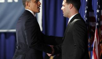 President Obama (left) is introduced by singer Ricky Martin at a fundraiser hosted by Mr. Martin and the LGBT Leadership Council at the Rubin Museum of Art in New York on Monday, May 14, 2012. (AP Photo/Pablo Martinez Monsivais)