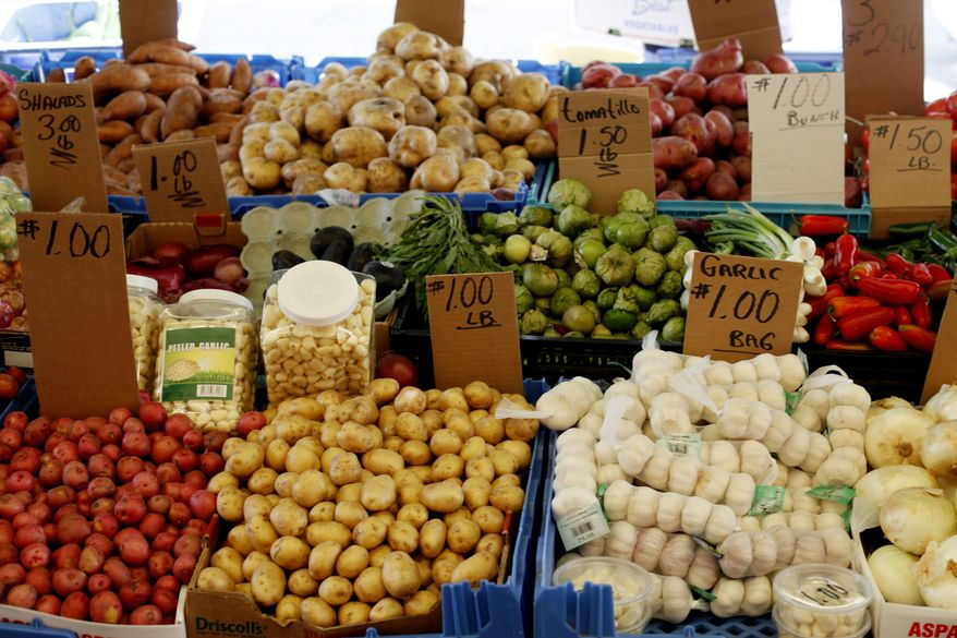 Vegetables are on display at a stand at the Italian Market in Philadelphia on Thursday, April 12, 2012. Fruit and vegetable prices jumped 1 percent in April, the most since July. (AP Photo/Matt Rourke)
